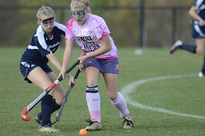 Danville's Sabrina Shrawder tries to keep the ball away from Mifflinburg's Maddie Zickgraf in Thursday's game at Danville.
