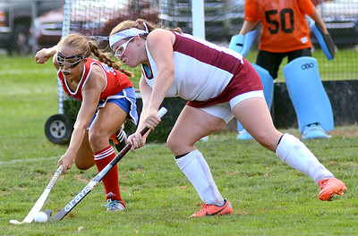 Selinsgrove's Lexi Horst and Shikellamy's Cory Yerger battle over control of the ball during their game Thursday Sept. 6, 2012 in Sunbury.