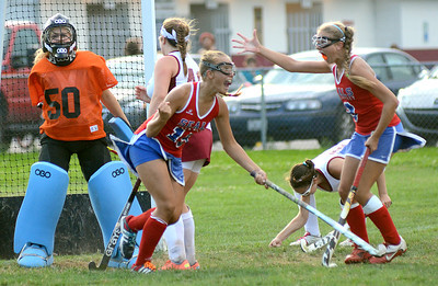 Selinsgrove's Lexi Horst, left, and Emily Klingler celebrate after Horst scored the tying goal during the second half of their game against Shikellamy Thursday Sept. 6, 2012 in Sunbury.