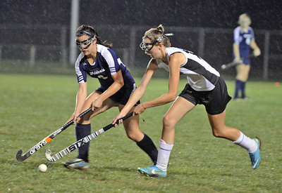 Mifflinburg's Morgan Unger (6) fights with Midd West's Candace Hackenburg (16) over control of the ball during the field hockey game in Middleburg on Thursday evening. Mifflinburg won 1-0.