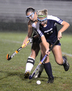 Mifflinburg's McKenzie Noll (14) steals the ball from a Midd West player during the field hockey game in Middleburg on Thursday night.