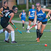 Lunenburg's Kayla Rhodes moves past an Oakmont defender in the Fast Break Field Hockey Summer League Championship Game at Doyle Field. SENTINEL&ENTERPRISE/ Jim Marabello