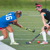 Oakmont's Taylor Ladue reacts to being hit by a shot from a Lunenburg player in the Fast Break Field Hockey Summer League Championship Game at Doyle Field. SENTINEL&ENTERPRISE/ Jim Marabello