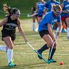 More ponytails fly as Oakmont's Jenna Duval battles Lunenburg's Sophie Shapiro in the Fast Break Field Hockey Summer League Championship Game at Doyle Field. SENTINEL&ENTERPRISE/ Jim Marabello