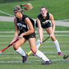 Ponytails fly as Oakmont's Maddie Moran cuts back against Lunenburg's Becca Handy in the Fast Break Field Hockey Summer League Championship Game at Doyle Field. SENTINEL&ENTERPRISE/ Jim Marabello
