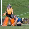 Lunenburg's Kayla Rhodes gets a stick on a shot in front of goalie Sam Gastonguay during the Fast Break Field Hockey Summer League Championship Game at Doyle Field. SENTINEL&ENTERPRISE/ Jim Marabello