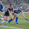 Oakmont's Taylor Ladue moves past Lunenburg's Grace Hedlund in the Fast Break Field Hockey Summer League Championship Game at Doyle Field. SENTINEL&ENTERPRISE/ Jim Marabello