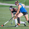 Lunenburg's Kayla Rhodes (right) tries to get a stick on a shot by Oakmont's Racheal Lemay during the Fast Break Field Hockey Summer League Championship Game at Doyle Field. SENTINEL&ENTERPRISE/ Jim Marabello