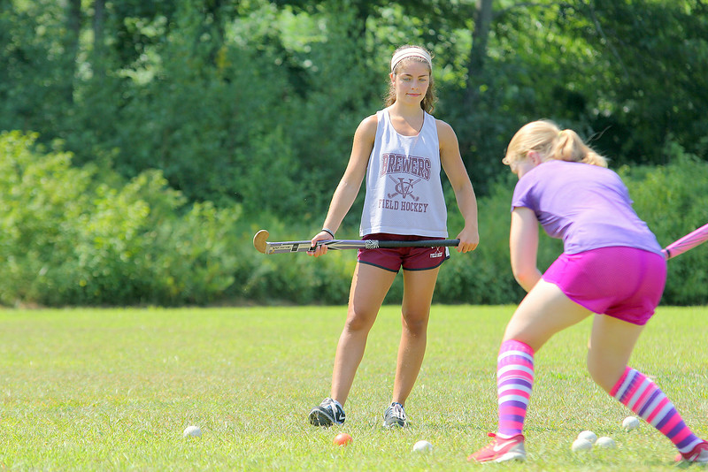 Bianca Zarrella, 20, watches over some students during the field hockey camp behind Leominster High School on Monday. SENTINEL & ENTERPRISE/JOHN LOVE