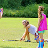 Bianca Zarrella, 20, shows students some moves during the field hockey camp behind Leominster High School on Monday. SENTINEL & ENTERPRISE/JOHN LOVE