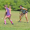 Dominique Zarrella, 19, on right plays a game called fishy, fishy, cross my ocean the field hockey addition during the field hockey camp behind Leominster High School on Monday. SENTINEL & ENTERPRISE/JOHN LOVE