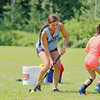 Dominique Zarrella, 19, on left plays a game called fishy, fishy, cross my ocean the field hockey addition during the field hockey camp behind Leominster High School on Monday. SENTINEL & ENTERPRISE/JOHN LOVE