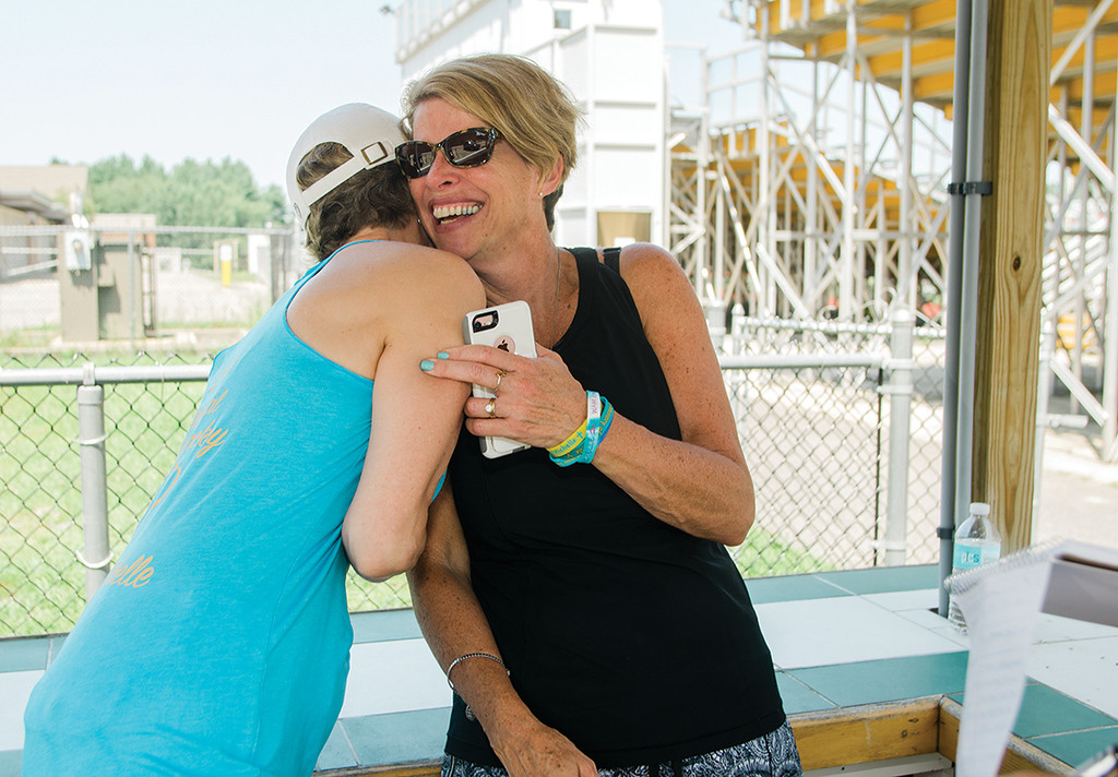 . Barbara and Brenda Farnsworth, Michelle\'s aunt and mother, embrace during the 4th annual Play Day for Michelle Farnsworth field hockey tournament held at Nashoba Regional High School on Friday, July 21, 2017. 15-year-old Farnsworth was a Nashoba sophomore when she lost her battle with rhabdomyosarcoma on January 13, 2015. SENTINEL & ENTERPRISE / Ashley Green