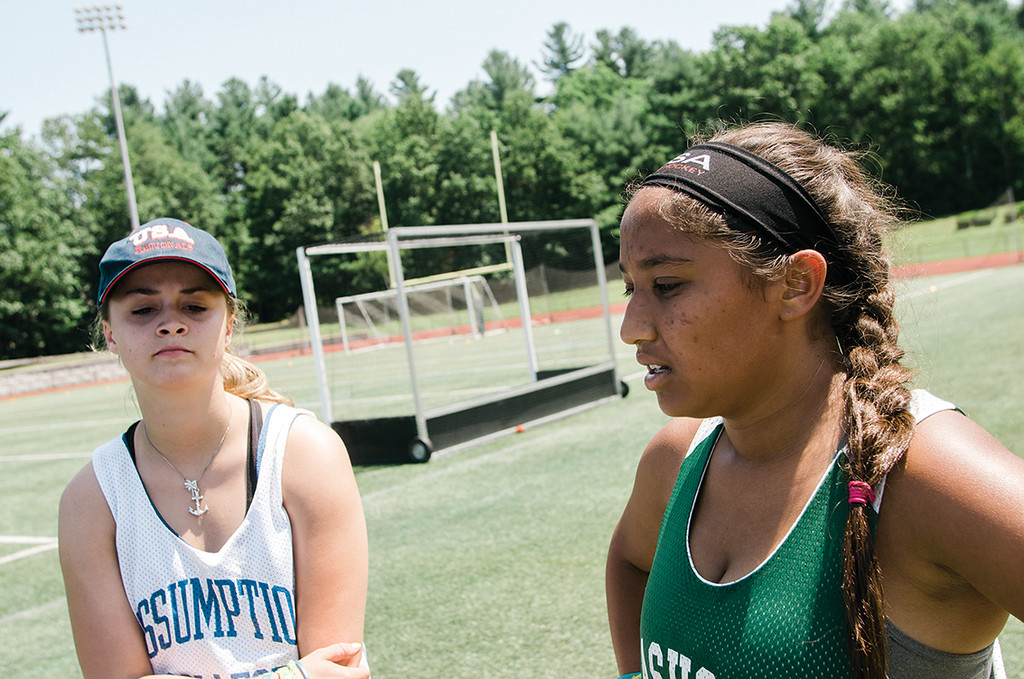 . Event organizers Nicholina Allain and Arushi Ahmed speak during the 4th annual Play Day for Michelle Farnsworth field hockey tournament, held at Nashoba Regional High School on Friday, July 21, 2017. 15-year-old Farnsworth was a Nashoba sophomore when she lost her battle with rhabdomyosarcoma on January 13, 2015. SENTINEL & ENTERPRISE / Ashley Green