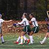 Oakmont girls rush teammate Meghan Fontaine after a successful penalty shot.  SENTINEL & ENTERPRISE/JOHN LOVE