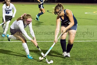 Oyster River's Julia Williams is defended by St Thomas Aquinas's Emma Fennessy during DII Varsity Field Hockey in Durham Tuesday night. Photo by Scott Patterson/Fosters.com