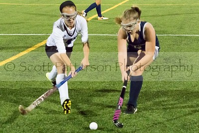 Oyster River's Laura Dreher and St Thomas Aquinas's Catherine Turr chase after a loose ball during DII Varsity Field Hockey in Durham Tuesday night. Photo by Scott Patterson/Fosters.com