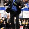Broomfield wresting coach Mark Schmidt jumps for joy after Josh Van Tine won his match to clinch the 4A State Championship for Broomfield.<br /> Cliff Grassmick / February 20, 2010
