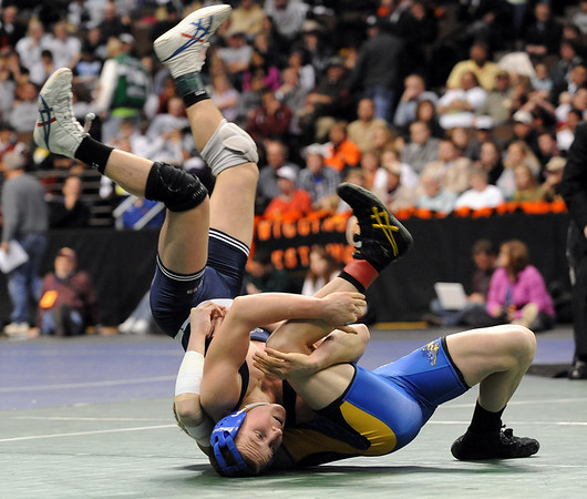 Nick Babcock, left, of Broomfield, gets flipped by Nick Swanson of Wheat Ridge. Babcock lost 7-6 at 130 pounds.<br /> Cliff Grassmick / February 20, 2010