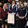 Courtland Hacker, center,  of Broomfield, wins the 4A state championship at 119 pounds.<br /> Cliff Grassmick / February 20, 2010