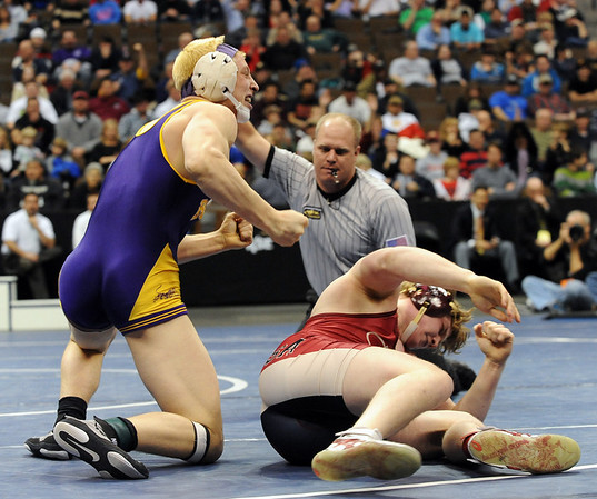 Max Wessell, left,   of Boulder High celebrates his 5A State Championship  over Derek Good of Ponderosa at 189 pounds  on Saturday night.<br /> Cliff Grassmick / February 20, 2010
