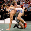 Jerry Huff, top, of Broomfield, lost the state 4A finals at 125 pounds  to Joseph Martinez of Greeley West.<br /> Cliff Grassmick / February 20, 2010
