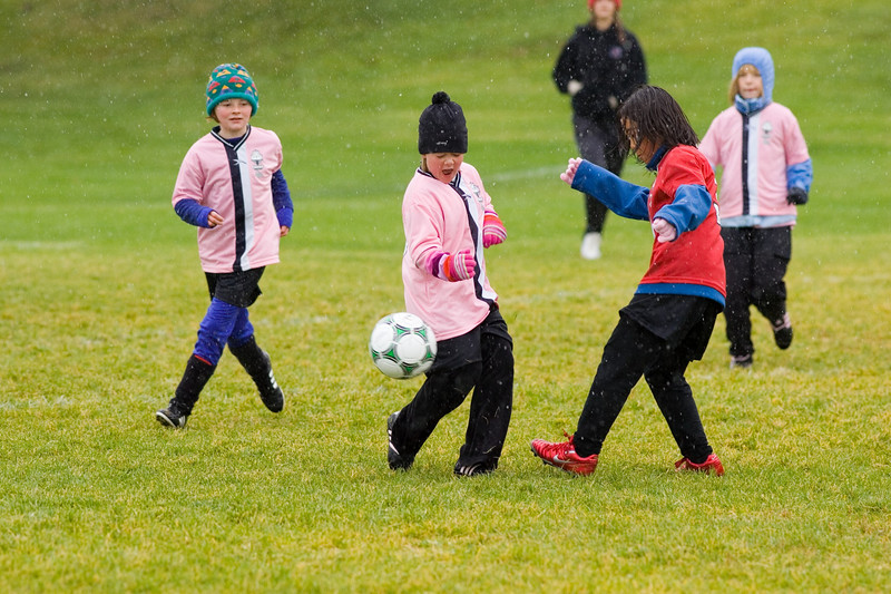 Girls club U10 playing on a cold rainly Saturday at 10:30. The Pink Panthers were leading the Red Blades at halftime when the game was called due to snow.