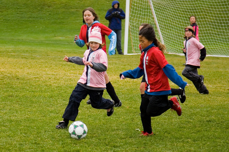 Meggie in pink hat. Girls club U10 playing on a cold rainly Saturday at 10:30. The Pink Panthers were leading the Red Blades at halftime when the game was called due to snow.