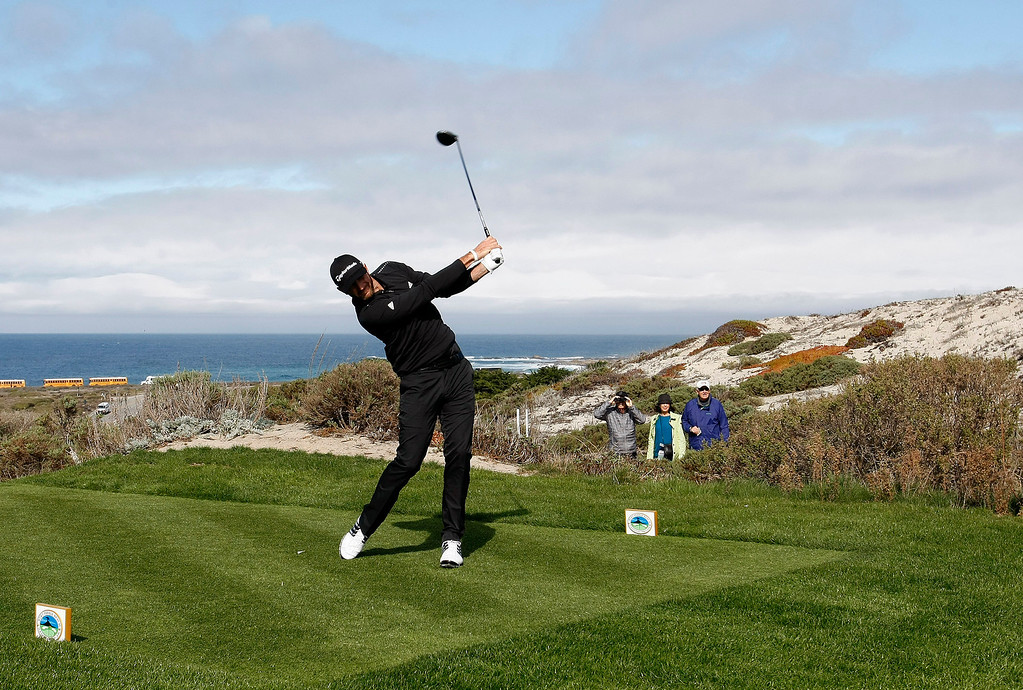 . Dustin Johnson tees off on the 6th hole at Spyglass Hill Golf Course during the first round of the AT&T Pebble Beach National Pro Am on Feb. 6, 2014.  (Vern Fisher/Monterey County Herald)
