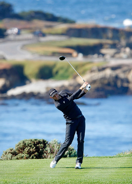. Dustin Johnson tees off on the 4th hole at Spyglass Hill Golf Course during the first round of the AT&T Pebble Beach National Pro Am on Feb. 6, 2014.  (Vern Fisher/Monterey County Herald)