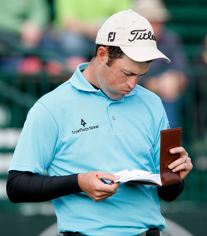 . Robert Streb checks his yardage book at the Pebble Beach Golf Links during the first round of the AT&T Pebble Beach National Pro Am on Feb. 6, 2014.  (Vern Fisher/Monterey County Herald)