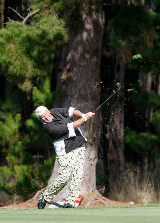 . John Daly hits his second shot on the 6th hole at Spyglass Hill Golf Course during the first round of the AT&T Pebble Beach National Pro Am on Feb. 6, 2014.  (Vern Fisher/Monterey County Herald)