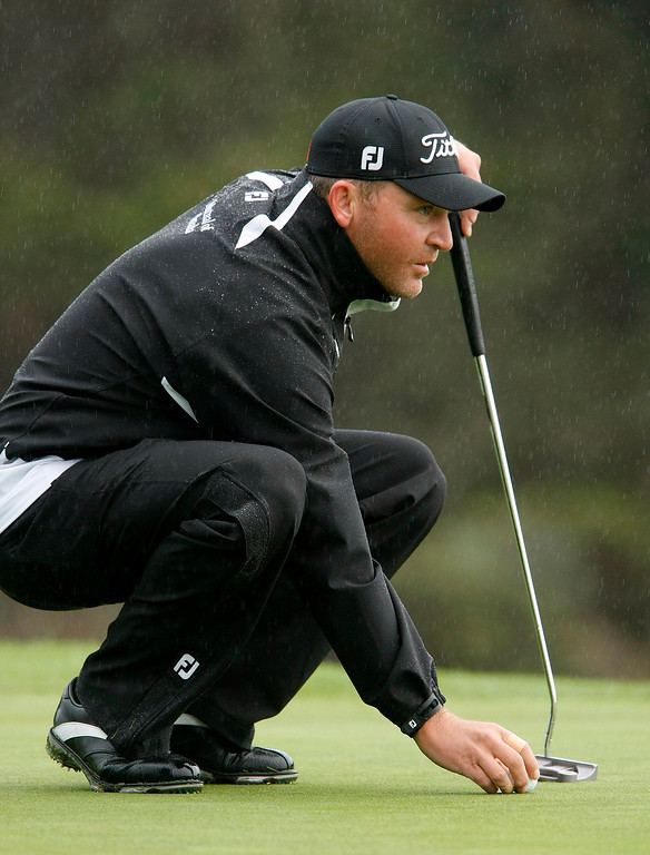 . Jason Bohn lines up a putt at Spyglass Hill Golf Course during the first round of the AT&T Pebble Beach National Pro Am on Feb. 6, 2014.  (Vern Fisher/Monterey County Herald)