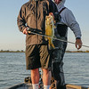 Andrew with a bass,and fishing guide Bobby Barrack, caught on the San Joaquin River in the Sacramento Delta. August 3, 2016