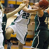 Fitchburg State University women's basketball played Mount Ida on Tuesday night at home. Looking to make a basket is FSU player Amy Fahey. SENTINEL & ENTERPRISE/ JOHN LOVE