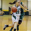 Fitchburg State University women's basketball played Mount Ida on Tuesday night at home. Mount Ida player Molly Alkinburg fouls FSu player Amy Fahey as she goes in for a basket. SENTINEL & ENTERPRISE/ JOHN LOVE