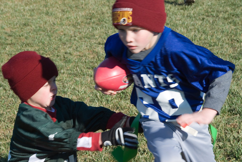 "Flag football -- Matthew Dimond (WJHS, no community designnation specified) is ""tackled"" after a long gain."