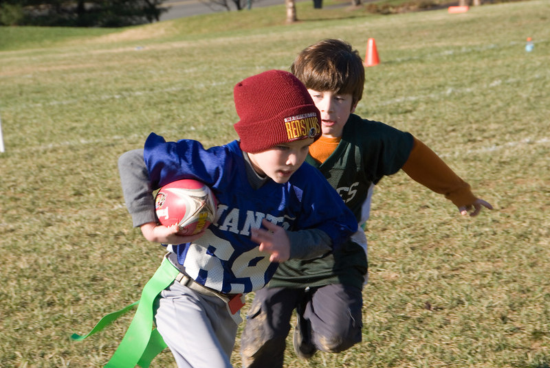 Flag football -- Matthew Dimond (WJHS, no community designnation specified)  tries to evade a tackler.