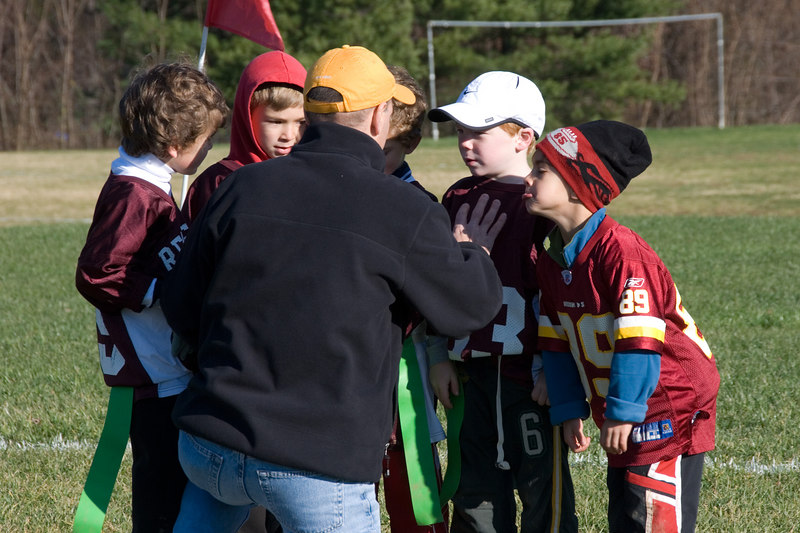 Flag football -- The coach calls a play.