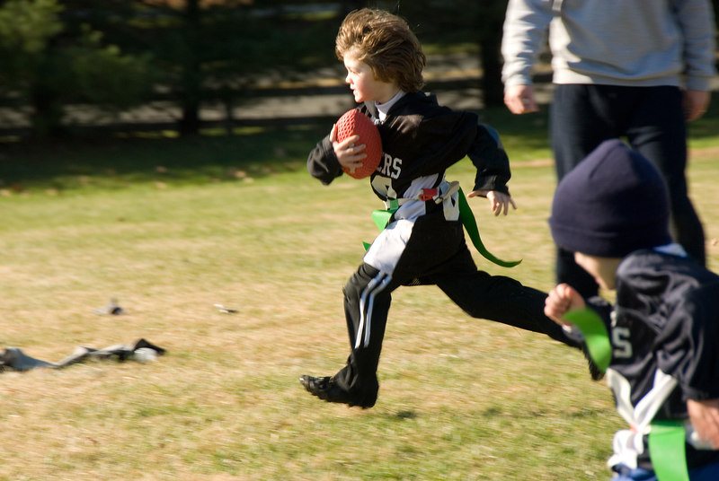 Flag football -- Hunter Band of Potomac races towards the goal line.