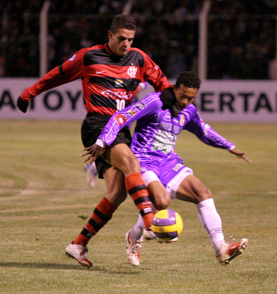 Flamengo's Renato, left, fights for the ball with Real Potos' defender during a Libertadores Cup in Potos', a Spanish-colonial silver mining town high in the Bolivian Andes, Feb. 14, 2007. Flamengo, Brazil's most popular club, is back in the Libertadores Cup (South America's version of the Champion's League) after a five-year absence. Real Potos', bought by a Real Madrid fan several years ago and who's emblem is remarkably similar to their Spanish counterpart, is in the tournament for the second time. Flamengo's trip to one of the world's highest professional soccer venues for the group 5 match against Potos' has proved a logistical nightmare for Flamengo because of the difficulties of playing at nearly 4,000 metres above sea level as well as the task of simply reaching the match venue. Potosi does not have a commercial airport and Flamengo flew to Sucre then made a three-hour bus journey up precipitous mountain roads to get there. Flamengo players were given bursts of oxygen during and after the match, which they managed to draw 2-2. Flamengo goals were scored in the 49th minute by Roni, who headed a free kick from the left, and Obina on an identical play in the 67th minute. After the match Flamengo leadership said that they will not play at that altitude again, prompting a controversy with the Bolivians, who say that they may refuse to play in Rio's 40 degree heat and humidity. Venezuela's Union AtlŽtico Maracaibo and Brazil's Paran‡ are also in group 5.