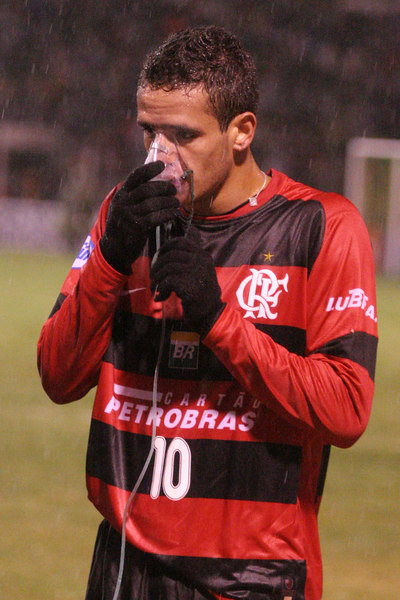 Flamengo's Renato takes oxygen during a Libertadores Cup match against Real Potos' in Potos', a Spanish-colonial silver mining town high in the Bolivian Andes, Feb. 14, 2007. Flamengo, Brazil's most popular club, is back in the Libertadores Cup (South America's version of the Champion's League) after a five-year absence. Real Potos', bought by a Real Madrid fan several years ago and who's emblem is remarkably similar to their Spanish counterpart, is in the tournament for the second time. Flamengo's trip to one of the world's highest professional soccer venues for the group 5 match against Potos' has proved a logistical nightmare for Flamengo because of the difficulties of playing at nearly 4,000 metres above sea level as well as the task of simply reaching the match venue. Potosi does not have a commercial airport and Flamengo flew to Sucre then made a three-hour bus journey up precipitous mountain roads to get there. Flamengo players were given bursts of oxygen during and after the match, which they managed to draw 2-2. Flamengo goals were scored in the 49th minute by Roni, who headed a free kick from the left, and Obina on an identical play in the 67th minute. After the match Flamengo leadership said that they will not play at that altitude again, prompting a controversy with the Bolivians, who say that they may refuse to play in Rio's 40 degree heat and humidity. Venezuela's Union AtlŽtico Maracaibo and Brazil's Paran‡ are also in group 5.