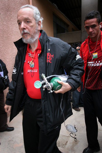 Flamengo team doctor Serafim Borges carries an oxygen tank into the Mario Mercado stadium before a Libertadores Cup match against Real Potosi in Potos', a Spanish-colonial silver mining town high in the Bolivian Andes, Feb. 14, 2007. Flamengo, Brazil's most popular club, is back in the Libertadores Cup (South America's version of the Champion's League) after a five-year absence. Real Potos', bought by a Real Madrid fan several years ago and who's emblem is remarkably similar to their Spanish counterpart, is in the tournament for the second time. Flamengo's trip to one of the world's highest professional soccer venues for the group 5 match against Potos' has proved a logistical nightmare for Flamengo because of the difficulties of playing at nearly 4,000 metres above sea level as well as the task of simply reaching the match venue. Potosi does not have a commercial airport and Flamengo flew to Sucre then made a three-hour bus journey up precipitous mountain roads to get there. Flamengo players were given bursts of oxygen during and after the match, which they managed to draw 2-2. Flamengo goals were scored in the 49th minute by Roni, who headed a free kick from the left, and Obina on an identical play in the 67th minute. After the match Flamengo leadership said that they will not play at that altitude again, prompting a controversy with the Bolivians, who say that they may refuse to play in Rio's 40 degree heat and humidity. Venezuela's Union AtlŽtico Maracaibo and Brazil's Paran‡ are also in group 5.