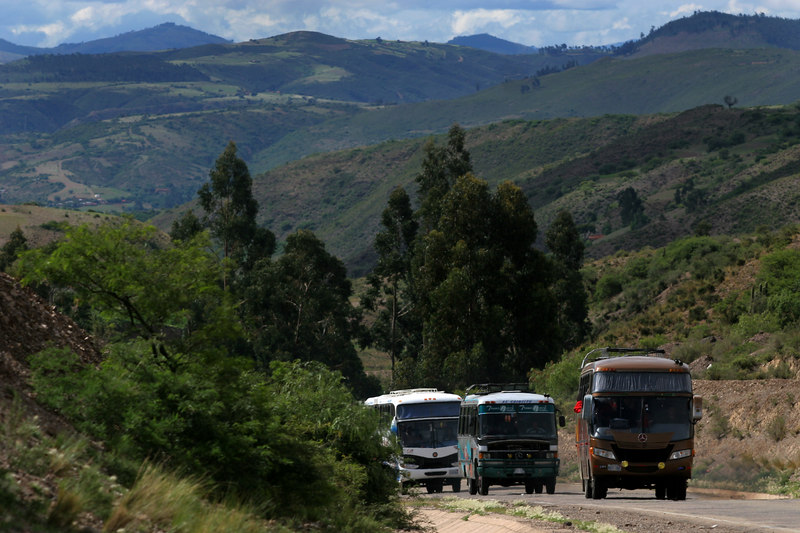 Members of the Brazil's Flamengo team travel in a bus caravan from Sucre, Bolivia, on a winding mountain road in for a Libertadores Cup match against Real Potosi in Potos', a Spanish-colonial silver mining town high in the Bolivian Andes, Feb. 14, 2007. Flamengo, Brazil's most popular club, is back in the Libertadores Cup (South America's version of the Champion's League) after a five-year absence. Real Potos', bought by a Real Madrid fan several years ago and who's emblem is remarkably similar to their Spanish counterpart, is in the tournament for the second time. Flamengo's trip to one of the world's highest professional soccer venues for the group 5 match against Potos' has proved a logistical nightmare for Flamengo because of the difficulties of playing at nearly 4,000 metres above sea level as well as the task of simply reaching the match venue. Potosi does not have a commercial airport and Flamengo flew to Sucre then made a three-hour bus journey up precipitous mountain roads to get there. Flamengo players were given bursts of oxygen during and after the match, which they managed to draw 2-2. Flamengo goals were scored in the 49th minute by Roni, who headed a free kick from the left, and Obina on an identical play in the 67th minute. After the match Flamengo leadership said that they will not play at that altitude again, prompting a controversy with the Bolivians, who say that they may refuse to play in Rio's 40 degree heat and humidity. Venezuela's Union AtlŽtico Maracaibo and Brazil's Paran‡ are also in group 5.
