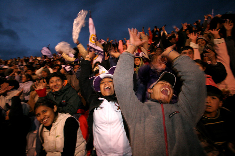 "Real Potosi fans perform the ""wave"" cheer in the sold-out 17,000 capacity Mario Mercado stadium before a Libertadores Cup match against Brazil's Flamengo in Potos', a Spanish-colonial silver mining town high in the Bolivian Andes, Feb. 14, 2007. Flamengo, Brazil's most popular club, is back in the Libertadores Cup (South America's version of the Champion's League) after a five-year absence. Real Potos', bought by a Real Madrid fan several years ago and who's emblem is remarkably similar to their Spanish counterpart, is in the tournament for the second time. Flamengo's trip to one of the world's highest professional soccer venues for the group 5 match against Potos' has proved a logistical nightmare for Flamengo because of the difficulties of playing at nearly 4,000 metres above sea level as well as the task of simply reaching the match venue. Potosi does not have a commercial airport and Flamengo flew to Sucre then made a three-hour bus journey up precipitous mountain roads to get there. Flamengo players were given bursts of oxygen during and after the match, which they managed to draw 2-2. Flamengo goals were scored in the 49th minute by Roni, who headed a free kick from the left, and Obina on an identical play in the 67th minute. After the match Flamengo leadership said that they will not play at that altitude again, prompting a controversy with the Bolivians, who say that they may refuse to play in Rio's 40 degree heat and humidity. Venezuela's Union AtlŽtico Maracaibo and Brazil's Paran‡ are also in group 5."