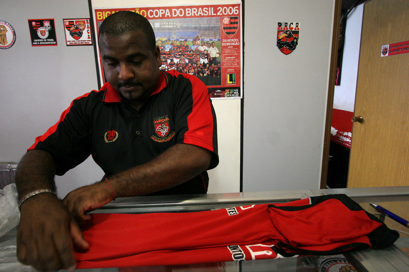 Flamengo fan club member and fan leader Junior organizes club shirts at the club office in Rio de Janeiro, Brazil, March 16, 2006. The fan club has profited from the team's recent sucesses. More members are joining and buying merchandise ever since last year's Copa do Brasil championship earned the team a spot in this year's Libertadores Cup (South America's version of the Champion's League) after a five-year absence.
