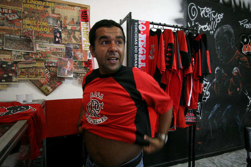 A Flamengo fan club member tries on a shirt at the club office in Rio de Janeiro, Brazil, March 16, 2006. The fan club has profited from the team's recent sucesses. More members are joining and buying merchandise ever since last year's Copa do Brasil championship earned the team a spot in this year's Libertadores Cup (South America's version of the Champion's League) after a five-year absence.