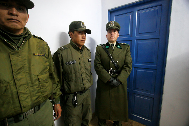 Bolivian police stand guard outside the Flamengo locker room after a Libertadores Cup match agains Real Potosi, in Potos', a Spanish-colonial silver mining town high in the Bolivian Andes, Feb. 14, 2007. Flamengo, Brazil's most popular club, is back in the Libertadores Cup (South America's version of the Champion's League) after a five-year absence. Real Potos', bought by a Real Madrid fan several years ago and who's emblem is remarkably similar to their Spanish counterpart, is in the tournament for the second time. Flamengo's trip to one of the world's highest professional soccer venues for the group 5 match against Potos' has proved a logistical nightmare for Flamengo because of the difficulties of playing at nearly 4,000 metres above sea level as well as the task of simply reaching the match venue. Potosi does not have a commercial airport and Flamengo flew to Sucre then made a three-hour bus journey up precipitous mountain roads to get there. Flamengo players were given bursts of oxygen during and after the match, which they managed to draw 2-2. Flamengo goals were scored in the 49th minute by Roni, who headed a free kick from the left, and Obina on an identical play in the 67th minute. After the match Flamengo leadership said that they will not play at that altitude again, prompting a controversy with the Bolivians, who say that they may refuse to play in Rio's 40 degree heat and humidity. Venezuela's Union AtlŽtico Maracaibo and Brazil's Paran‡ are also in group 5.