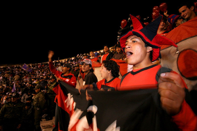 Bolivian fans of Flamengo cheer on the team In the 17,000 capacity Mario Mercado stadium in Potos', a Spanish-colonial silver mining town high in the Bolivian Andes, Feb. 14, 2007. Flamengo, Brazil's most popular club, is back in the Libertadores Cup (South America's version of the Champion's League) after a five-year absence. Real Potos', bought by a Real Madrid fan several years ago and who's emblem is remarkably similar to their Spanish counterpart, is in the cup for the second time. Flamengo's trip to one of the world's highest professional soccer venues for the group 5 match against Potos' has proved a logistical nightmare for Flamengo because of the difficulties of playing at nearly 4,000 metres above sea level as well as the task of simply reaching the match venue. Potosi does not have a commercial airport and Flamengo flew to Sucre then made a three-hour bus journey up precipitous mountain roads to get there. Flamengo players were given bursts of oxygen during and after the match, which they managed to draw 2-2. Flamengo goals were scored in the 49th minute by Roni, who headed a free kick from the left, and Obina on an identical play in the 67th minute. After the match Flamengo leadership said that they will not play at that altitude again, prompting a controversy with the Bolivians, who say that they may refuse to play in Rio's 40 degree heat and humidity. Venezuela's Union AtlŽtico Maracaibo and Brazil's Paran‡ are also in group 5.