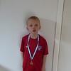 Stolt hjemme med første medalje